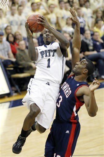 Pittsburgh's Tray Woodall (1) drives to the basket past Howard's Mike Phillips (13) in the first half of an NCAA college basketball game Tuesday, Nov. 27, 2012, in Pittsburgh. (AP Photo/Keith Srakocic)
