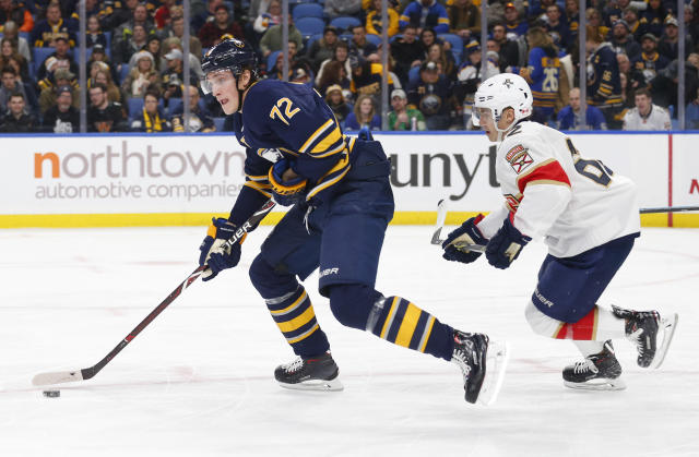 Buffalo Sabres forward Tage Thompson (72) is chased by Florida Panthers forward Denis Malgin (62) during the second period of an NHL hockey game, Tuesday, Dec. 18, 2018, in Buffalo N.Y. (AP Photo/Jeffrey T. Barnes)