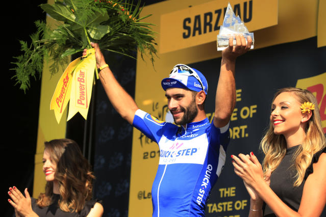 Stage winner Fernando Gaviria of Colombia celebrates on the podium after the fourth stage of the Tour de France cycling race over 195 kilometers (121 miles) with start in La Baule and finish in Sarzeau, France, Tuesday, July 10, 2018. (AP Photo/Peter Dejong)