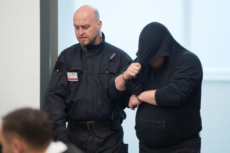 "Members of the so-called ""Freital group"" were escorted into the courtroom in Dresden before being sentenced"
