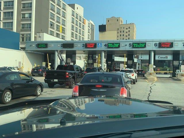 Cars line up to enter Canada from Detroit on Monday, Aug. 9, the first day vaccinated Americans may visit Canada for nonessential travel since the pandemic.
