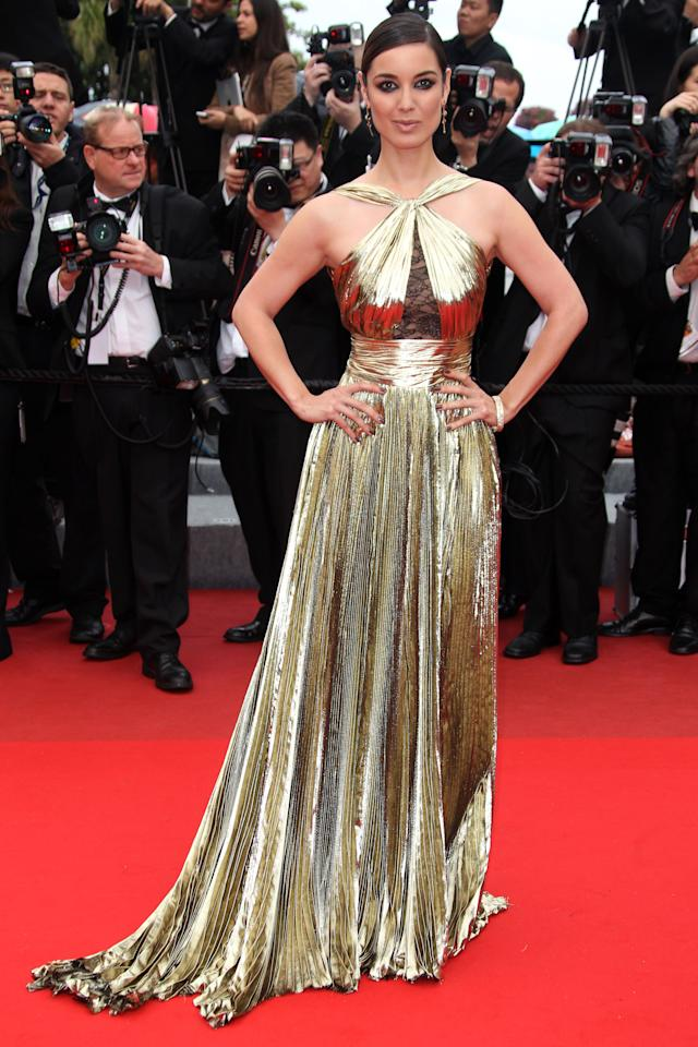 Actress Berenice Marlohe wears Emilio Pucci as she arrives for the screening of You Ain't Seen Nothing Yet at the 65th international film festival, in Cannes, southern France, Monday, May 21, 2012. (AP Photo/Joel Ryan)