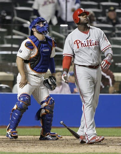 Philadelphia Phillies' Ryan Howard, right, drops his bat after hitting a home run as New York Mets catcher Kelly Shoppach watches the ball during the ninth inning of a baseball game on Wednesday, Sept. 19, 2012, in New York. (AP Photo/Frank Franklin II)