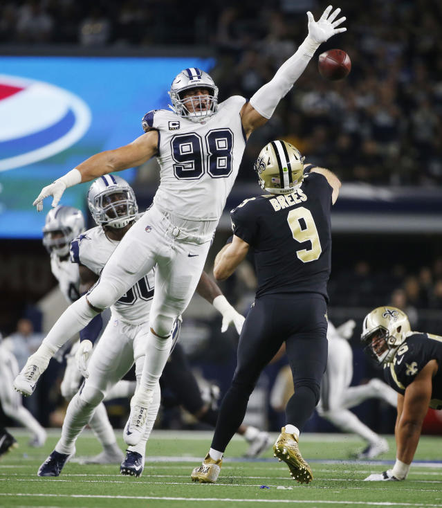 New Orleans Saints quarterback Drew Brees (9) is pressured by Dallas Cowboys defensive tackle Tyrone Crawford (98) as he passes during the second half of an NFL football game, in Arlington, Texas, Thursday, Nov. 29, 2018. (AP Photo/Ron Jenkins)