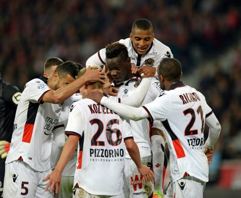 Nice's Mario Balotelli celebrates with teammates after scoring a goal  during the French L1 football match against Lille on April 07, 2017