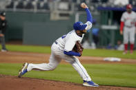 Kansas City Royals starting pitcher Danny Duffy delivers to a Los Angeles Angels batter during the third inning of a baseball game at Kauffman Stadium in Kansas City, Mo., Tuesday, April 13, 2021. (AP Photo/Orlin Wagner)