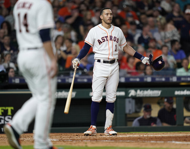 Houston Astros' Carlos Correa reacts after grounding into a double play against the Cleveland Indians during the sixth inning of a baseball game Thursday, April 25, 2019, in Houston. (AP Photo/David J. Phillip)