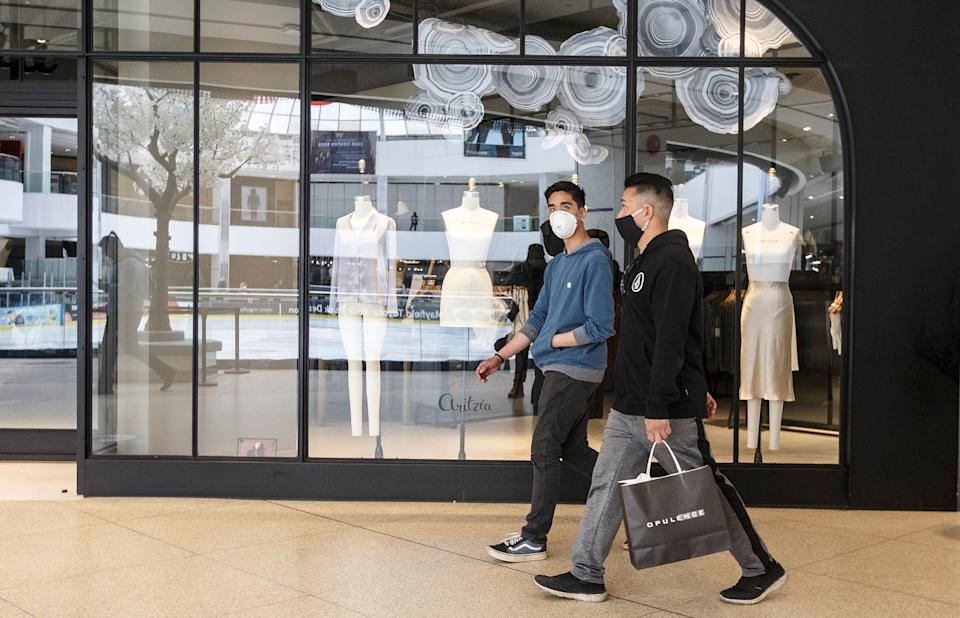 Shoppers walk past stores in West Edmonton Mall in Edmonton on May 14, 2020.  (Photo: Jason Franson/THE CANADIAN PRESS)