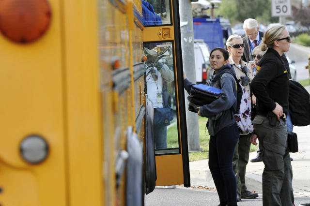 Students evacuate their campus after a gunman opened fire at Saugus High School on Nov. 14, 2019, in Santa Clarita, Calif. (Photo: Christian Monterrosa/AP)
