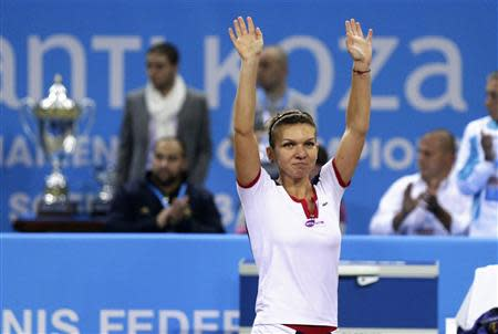 Halep of Romania celebrates defeating Stosur of Australia during the WTA Tournament of Champions final match in Sofia