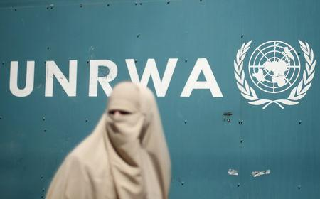 A Palestinian woman takes part in a protest against possible reductions of the services and aid offered by UNRWA in front of UNRWA headquarters in Gaza City