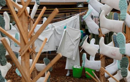 FILE PHOTO: A healthcare worker holds washed parts of protective gear at a transit centre in Beni, North Kivu Province of Democratic Republic of Congo, December 15, 2018.   REUTERS/Goran Tomasevic/File Photo