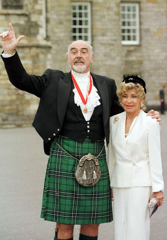 Sir Sean Connery, with wife Micheline, donning full Highland dress