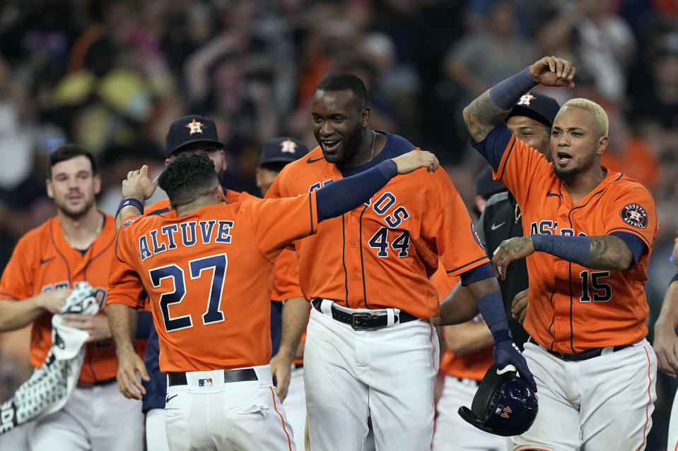 Houston Astros' Yordan Alvarez (44) celebrates with Jose Altuve (27) after hitting a game-winning RBI-double against the Chicago White Sox during the ninth inning of a baseball game Friday, June 18, 2021, in Houston. The Astros won 2-1.(AP Photo/David J. Phillip)