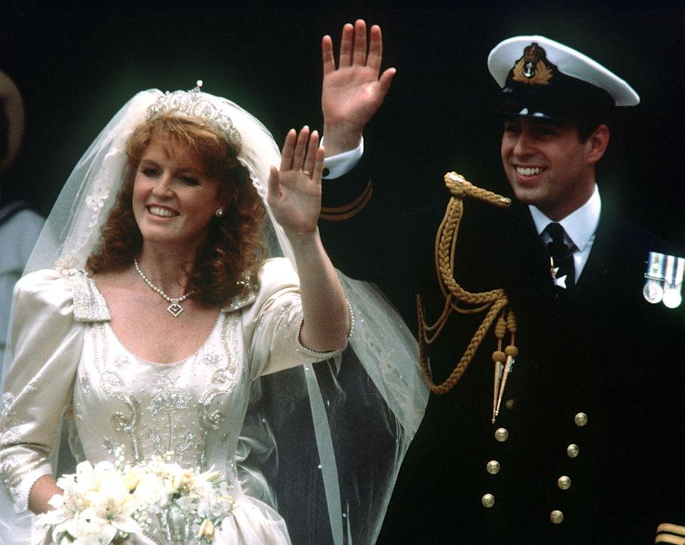"<p>When Fergie walked down the aisle, her gown held a great deal of significance, according to the <a href=""http://articles.latimes.com/1986-07-24/news/mn-31456_1_royal-wedding"" rel=""nofollow noopener"" target=""_blank"" data-ylk=""slk:Los Angeles Times"" class=""link rapid-noclick-resp""><em>Los Angeles Times</em></a>. The gown itself was beaded with bees and thistles, representing the bride's coat of arms. Anchors and waves were embroidered on her veil to signify hubby Andrew's position as an officer in the Royal Navy, along with his monogram. Finally, four S's for Sarah were beaded on the bodice.</p>"