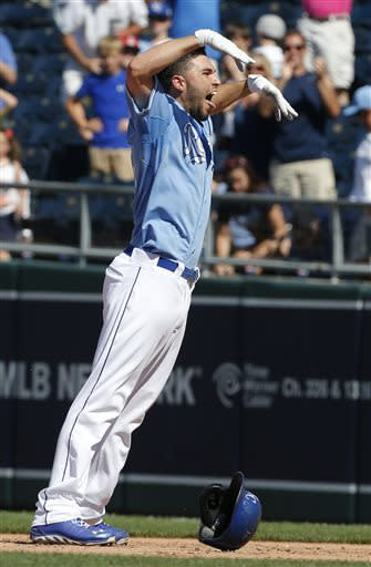 Kansas City Royals' Eric Hosmer celebrates his game-winning RBI single during the 10th inning of a baseball game against the Detroit Tigers at Kauffman Stadium in Kansas City, Mo., Wednesday, June 12, 2013. The Royals defeated the Tigers 3-2 in 10 innings. (AP Photo/Orlin Wagner)