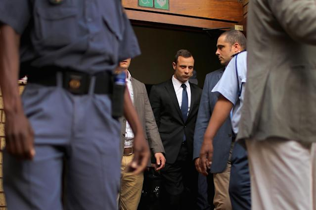 PRETORIA, SOUTH AFRICA - MARCH 06: Oscar Pistorius (C) leaves North Gauteng High Court at the end of the fourth day of his trial on March 6, 2014 in Pretoria, South Africa. Olympic and Paralympic athlete Oscar Pistorius, aged 27, is accused of murdering his girlfriend Reeva Steenkamp. Pistorius denies the allegation claiming he mistook Steenkamp for an intruder inside their home on Valentines Day 2013. (Photo by Christopher Furlong/Getty Images)