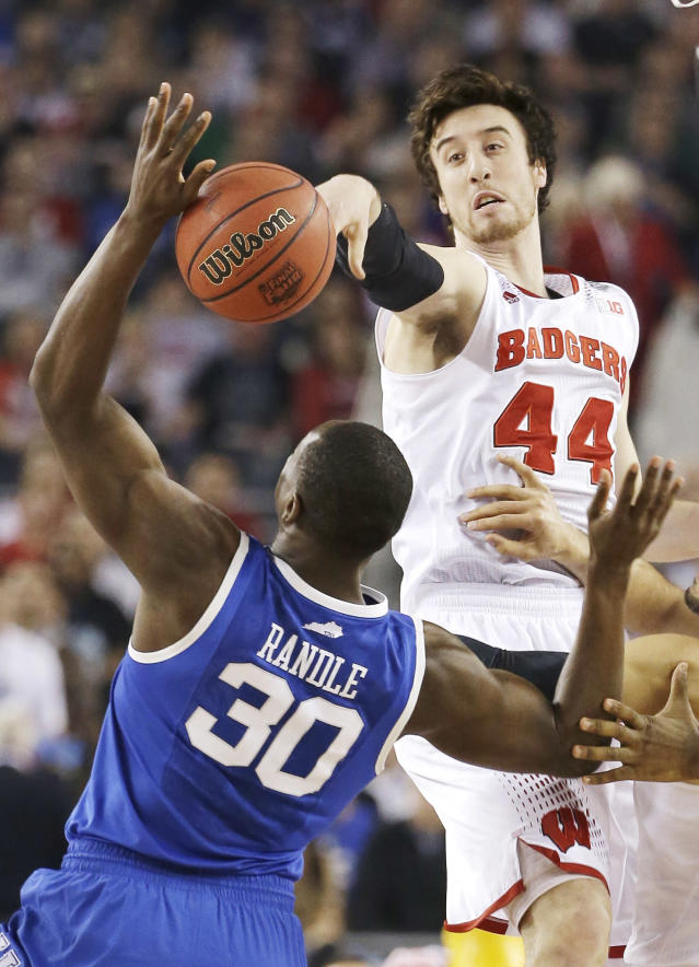 Wisconsin forward Frank Kaminsky (44) and Kentucky forward Julius Randle (30) tip the ball to begin their NCAA Final Four tournament college basketball semifinal game Saturday, April 5, 2014, in Arlington, Texas. (AP Photo/David J. Phillip)