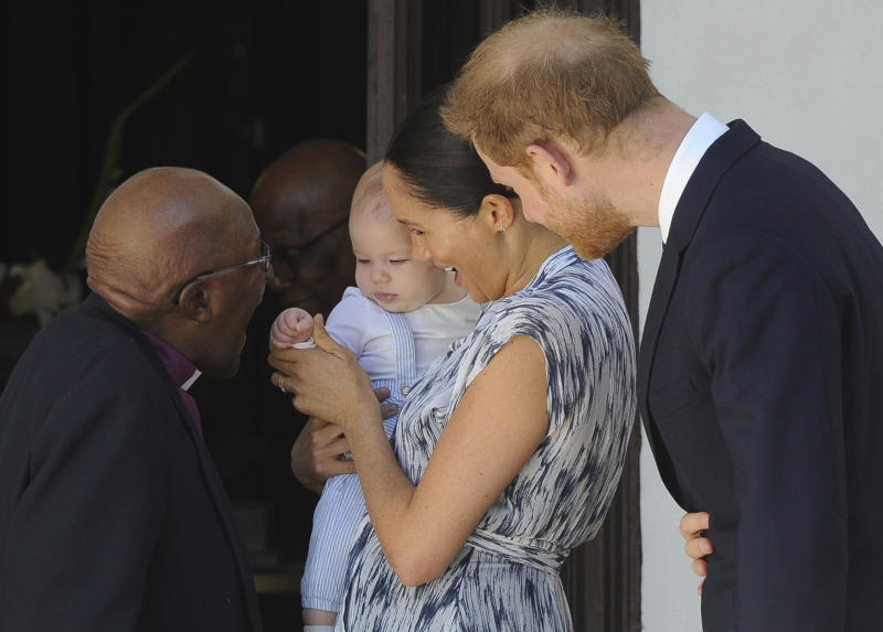Britain's Prince Harry and Meghan, Duchess of Sussex, holding their son Archie, meets with Anglican Archbishop Emeritus, Desmond Tutu, in Cape Town, South Africa Wednesday, Sept. 25, 2019. The royal couple are on the third day of their African tour. (Henk Kruger/African News Agency via AP, Pool)