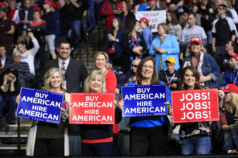 People wait for President Donald Trump to speak at a rally in Grand Rapids, Mich., Thursday, March 28, 2019. (AP Photo/Manuel Balce Ceneta)