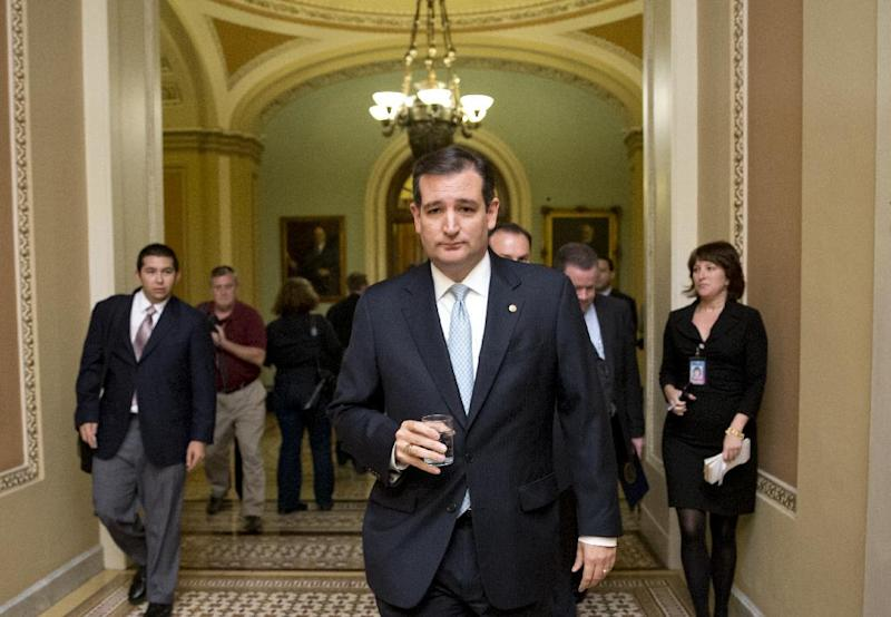 FILE - In this Oct. 16, 2013, file photo, Tea party conservative Sen. Ted Cruz, R-Texas, walks to a meeting as the Senate prepares to vote on a measure to avert a threatened Treasury default and reopen the government after a partial, 16-day shutdown, at the Capitol in Washington. Cruz took nothing short of a victory lap in his state of Texas this week, appearing before crowds that overlooked the fact that the Republican who led the charge to kill money for President Barack Obama's health care law had failed. Now he's coming to Iowa, where Republicans have the first say in the presidential race, and will view him much more skeptically. (AP Photo/J. Scott Applewhite, File)