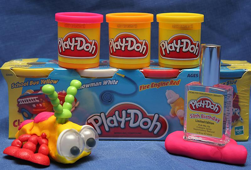 "Manassas, UNITED STATES: This 24 May, 2006 image shows a bottle of ""Play-Doh"" cologne (R), a fragrance released by Pawtucket, Rhode Island.-based toymaker Hasbro and the Demeter Fragrance Libray, the cologne?s New York manufacturer and distributor, as part of a year-long celebration of the beloved modeling compound's 50th birthday. ""Play-Doh"" compound's distinctive aroma will be available in a limited-edition 1-ounce spray bottle priced at 19 USD and a four-ounce (113 gram) bottle for 39.50 USD. A can of Play-Doh costs about 50 cents USD. Signatures of the Play-Doh brand is its scent,? Play-Doh is one of those scents that seems to evoke a very strong emotional response in everyone, because we all remember those good times as kids playing with Play-Doh,"" said Mark Crames, CEO of Demeter Fragrance Library. AFP PHOTO/Karen BLEIER (Photo credit should read KAREN BLEIER/AFP via Getty Images)"