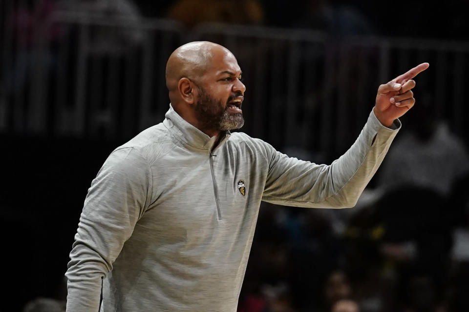 Cleveland Cavaliers coach J.B. Bickerstaff yells to players on the floor during the second half of the team's NBA preseason basketball game against the Atlanta Hawks on Wednesday, Oct. 6, 2021, in Atlanta. (AP Photo/John Bazemore)