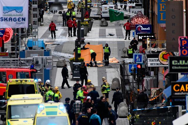<p>APR. 7, 2017 – Emergency services work at the scene where a truck crashed into the Ahlens department store at Drottninggatan in central Stockholm, Sweden.<br> (Photo: Jonathan Nackstrand/AFP/Getty Images) </p>