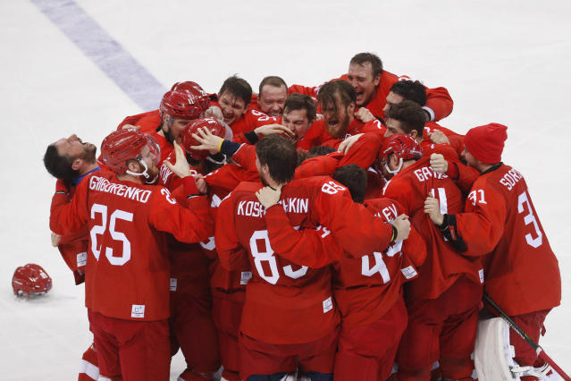 Olympic athletes from Russia celebrate after winning the men's gold medal hockey game against Germany, 4-3, in overtime at the 2018 Winter Olympics, Sunday, Feb. 25, 2018, in Gangneung, South Korea. (AP Photo/Jae C. Hong)