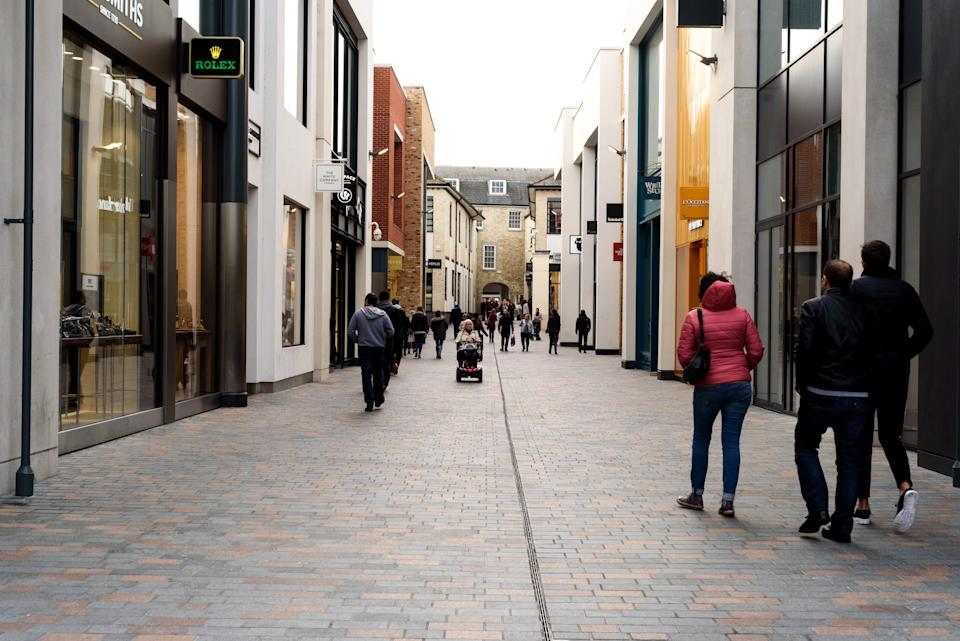 Shoppers during the daytime walking through the newly constructed Bond Street