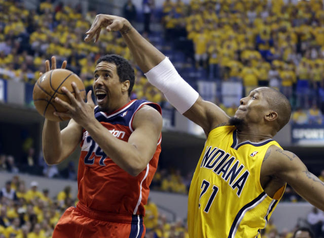 Indiana Pacers forward David West, right, comes from behind to block the shot of Washington Wizards guard Andre Miller during the second quarter of game 1 of the Eastern Conference semifinal NBA basketball playoff series in Indianapolis, Monday, May 5, 2014(AP Photo/Michael Conroy)