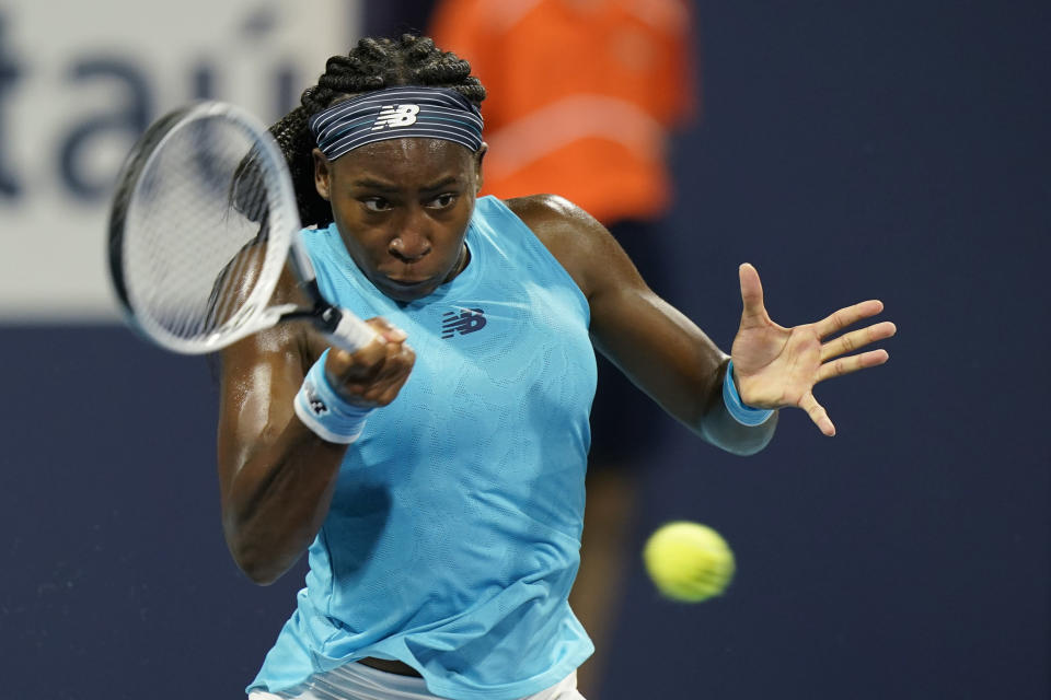 FILE - In this March 25, 2021 file photo, Coco Gauff, of the United States, returns a shot from Anastasija Sevastova, of Latvia, during the Miami Open tennis tournament in Miami Gardens, Fla. Gauff is just 17 but she's now a Top 25 tennis player who is dreaming of being No. 1 and a Grand Slam champion one day. (AP Photo/Wilfredo Lee, File)