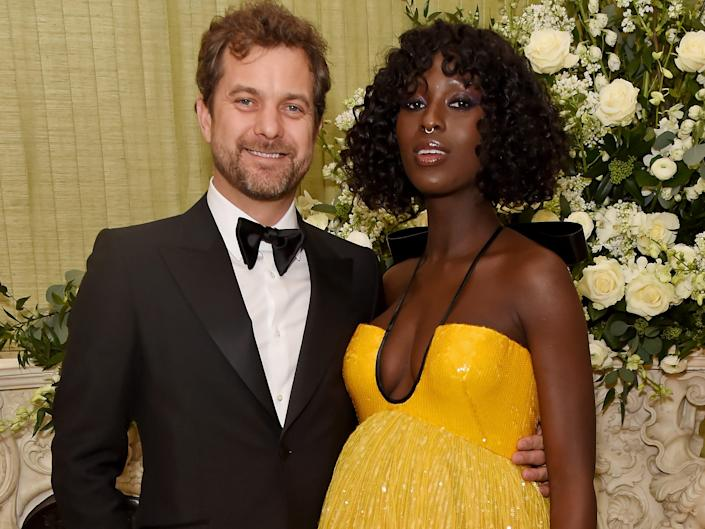 Joshua Jackson stands with his arm around his wife, Jodie Turner-Smith.