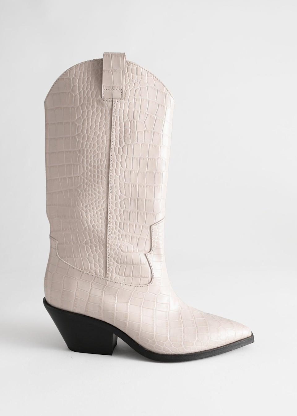 """<br><br><strong>& Other Stories</strong> Croc Embossed Leather Cowboy Boots, $, available at <a href=""""https://www.stories.com/en_gbp/shoes/boots/product.croc-embossed-leather-cowboy-boots-white.0794834001.html"""" rel=""""nofollow noopener"""" target=""""_blank"""" data-ylk=""""slk:& Other Stories"""" class=""""link rapid-noclick-resp"""">& Other Stories</a>"""