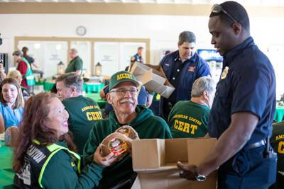 American Canyon Firefighters hand out Hormel® Cure 81® holiday hams to CERT/CART members at Thanksgiving luncheon.