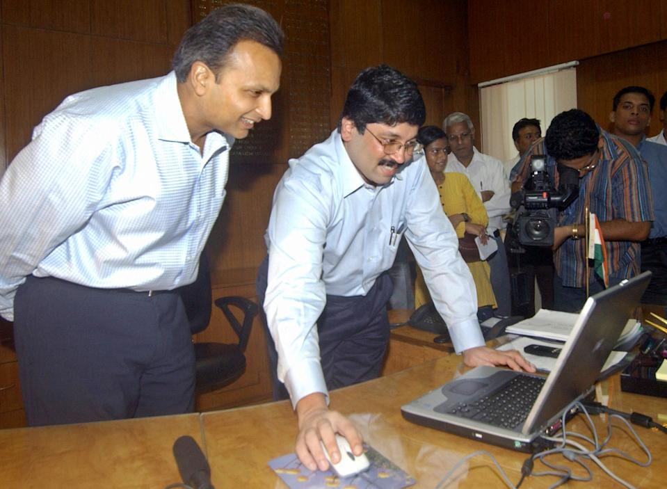 "Indian Information Technology and Communication Minister Dayanidhi Maran (R) works on a computer as Member of Parliament (MP) and Vice-Chairman of the telecommunications and petroleum Reliance group Anil Ambani (L) looks on, at the Communication Ministry in New Delhi, 06 August 2004. Maran launched 06 August the Indian Global Communications platform website, describing it as ""a technological initiative which will encourage new standards of transparency in public life"". AFP PHOTO/RAVEENDRAN"