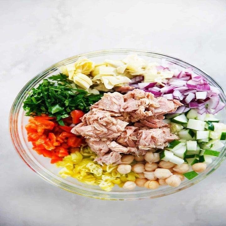 Tuna salad ingredients in a bowl.