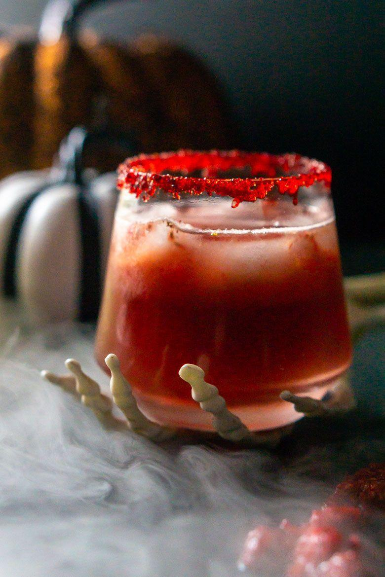 """<p>A handful of muddled raspberries gives this drink its """"zombie brain"""" appearance. Use pomegranate juice to add color and freshly squeezed orange juice for the sweet flavor. </p><p><strong>Get the recipe at <a href=""""https://burrataandbubbles.com/zombie-brains-halloween-cocktail/"""" rel=""""nofollow noopener"""" target=""""_blank"""" data-ylk=""""slk:Burrata and Bubbles"""" class=""""link rapid-noclick-resp"""">Burrata and Bubbles</a>. </strong></p><p><a class=""""link rapid-noclick-resp"""" href=""""https://go.redirectingat.com?id=74968X1596630&url=https%3A%2F%2Fwww.walmart.com%2Fsearch%2F%3Fquery%3Dcocktail%2Bmuddler&sref=https%3A%2F%2Fwww.thepioneerwoman.com%2Fholidays-celebrations%2Fg36982659%2Fhalloween-drink-recipes%2F"""" rel=""""nofollow noopener"""" target=""""_blank"""" data-ylk=""""slk:SHOP COCKTAIL MUDDLER"""">SHOP COCKTAIL MUDDLER</a></p>"""
