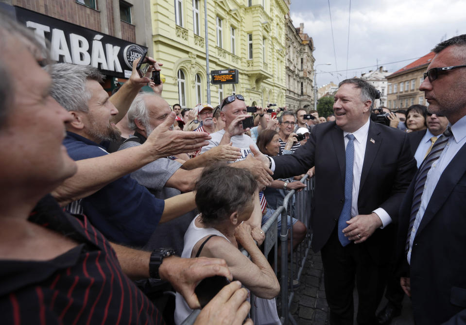 U.S. Secretary of State Mike Pompeo, right, shakes hands with citizens in Pilsen near Prague, Czech Republic, Tuesday, Aug. 11, 2020. U.S. Secretary of State Mike Pompeo is in Czech Republic at the start of a four-nation tour of Europe. Slovenia, Austria and Poland are the other stations of the trip. (AP Photo/Petr David Josek, Pool)