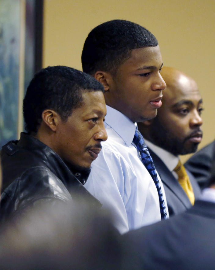 Ma'lik Richmond, center, stands with his father, Nathaniel Richmond, left, and attorney Walter Madison after he and co-defendant Trent Mays, 17, were found delinquent on rape and other charges after their trial in juvenile court in Steubenville, Ohio, Sunday, March 17, 2013. Mays and Richmond were accused of raping a 16-year-old West Virginia girl in August 2012. (AP Photo/Keith Srakocic, Pool)