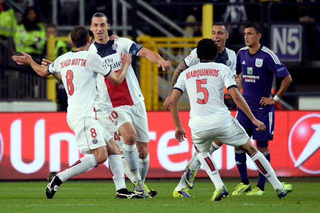 PSG player Zlatan Ibrahimovic, 2nd left, celebrates with teammates after scoring an hat trick against RSC Anderlecht during their Group C Champions League soccer match in Brussels on Wednesday, Oct. 23, 2013. (AP Photo/Geert Vanden Wijngaert)