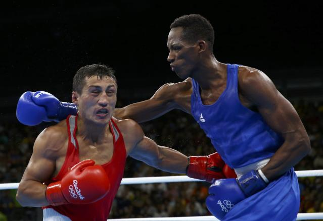 2016 Rio Olympics - Boxing - Final - Men's Light Welter (64kg) Final Bout 272 - Riocentro - Pavilion 6 - Rio de Janeiro, Brazil - 21/08/2016. Fazliddin Gaibnazarov (UZB) of Uzbekistan and Collazo Sotomayor (AZE) of Azerbaijan compete. REUTERS/Peter Cziborra FOR EDITORIAL USE ONLY. NOT FOR SALE FOR MARKETING OR ADVERTISING CAMPAIGNS.