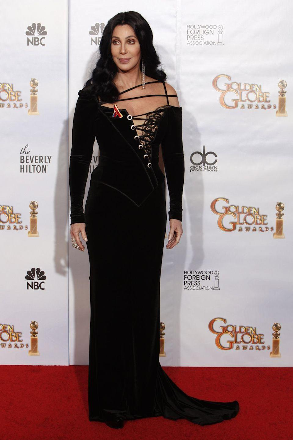 <p>In a black strappy gown at the Golden Globe Awards.</p>