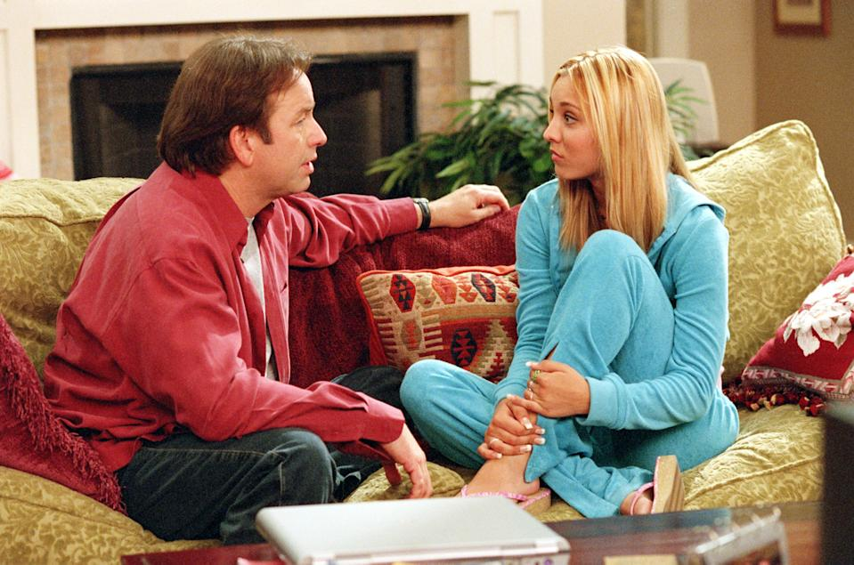 """As a teenager, Kaley Cuoco, right, played the daughter of John Ritter's character in ABC's """"8 Simple Rules,"""" which premiered in 2002."""