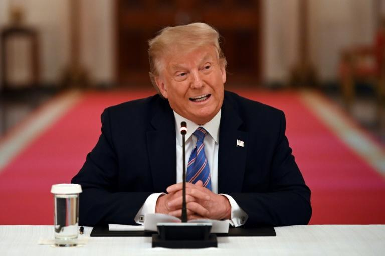 President Donald Trump, who is pulling the United States out of the World Health Organization over its coronavirus response, speaks at a roundtable discussion on reopening schools from the virus