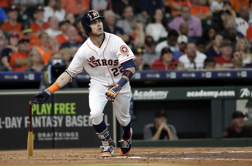 Houston Astros' Josh Reddick watches his home run against the Arizona Diamondbacks during the second inning of a baseball game Saturday, Sept. 15, 2018, in Houston. (AP Photo/David J. Phillip)