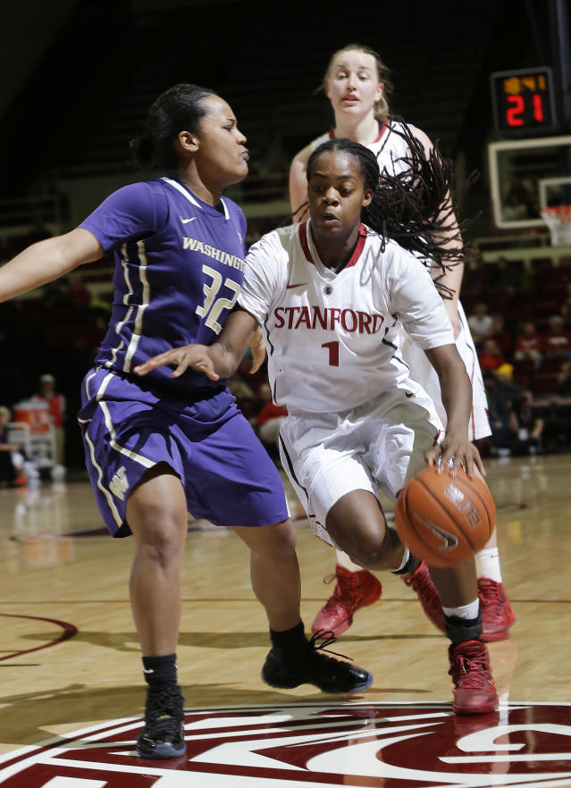 Stanford guard Lili Thompson (1) dribbles next to Washington guard Jazmine Davis (32) during the second half of an NCAA college basketball game on Thursday, Feb. 27, 2014, in Stanford, Calif. Stanford won 83-60. (AP Photo/Marcio Jose Sanchez)