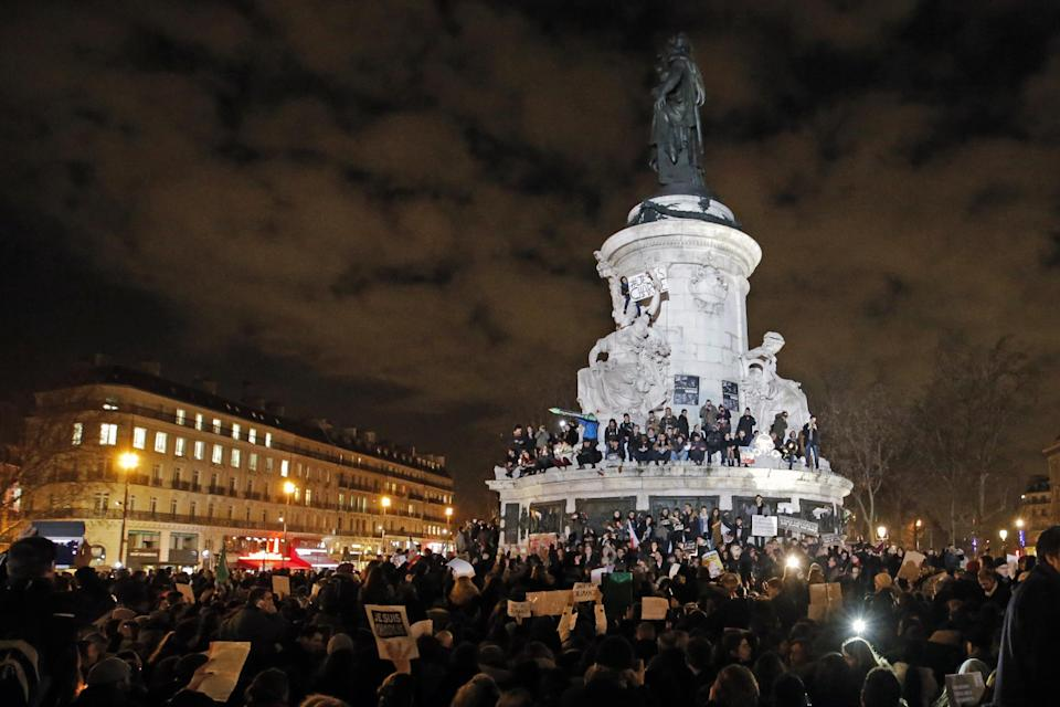 CLICK IMAGE for slideshow - People gather around and on top of the Republique Plaza statue during the solidarity demonstration in Paris, Thursday, Jan. 8, 2015. (AP Photo/Francois Mori)
