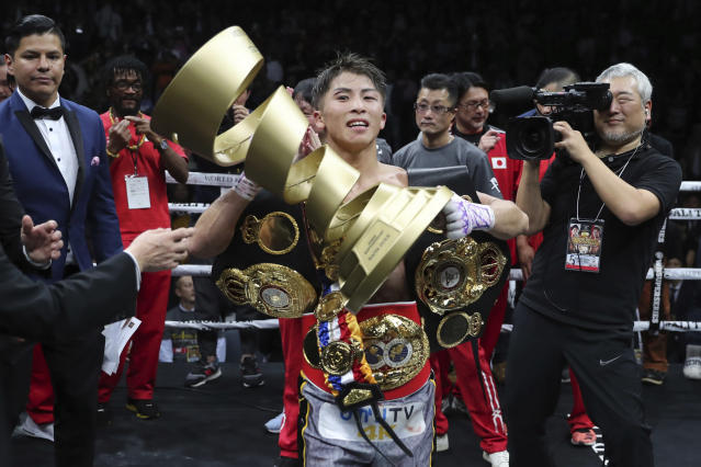 Japan's Naoya Inoue holds the Muhammad Ali Trophy after winning the World Boxing Super Series bantamweight final match in Saitama, Japan, Thursday, Nov. 7, 2019. Inoue beat Philippines' Nonito Donaire with a unanimous decision to win the championship. (AP Photo/Toru Takahashi)