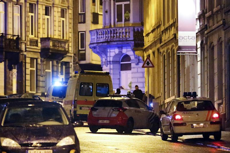 Police cars and vans are parked in a street as police set up a large security perimeter in the city center of Verviers, eastern Belgium on January 15, 2015 (AFP Photo/Bruno Fahy)